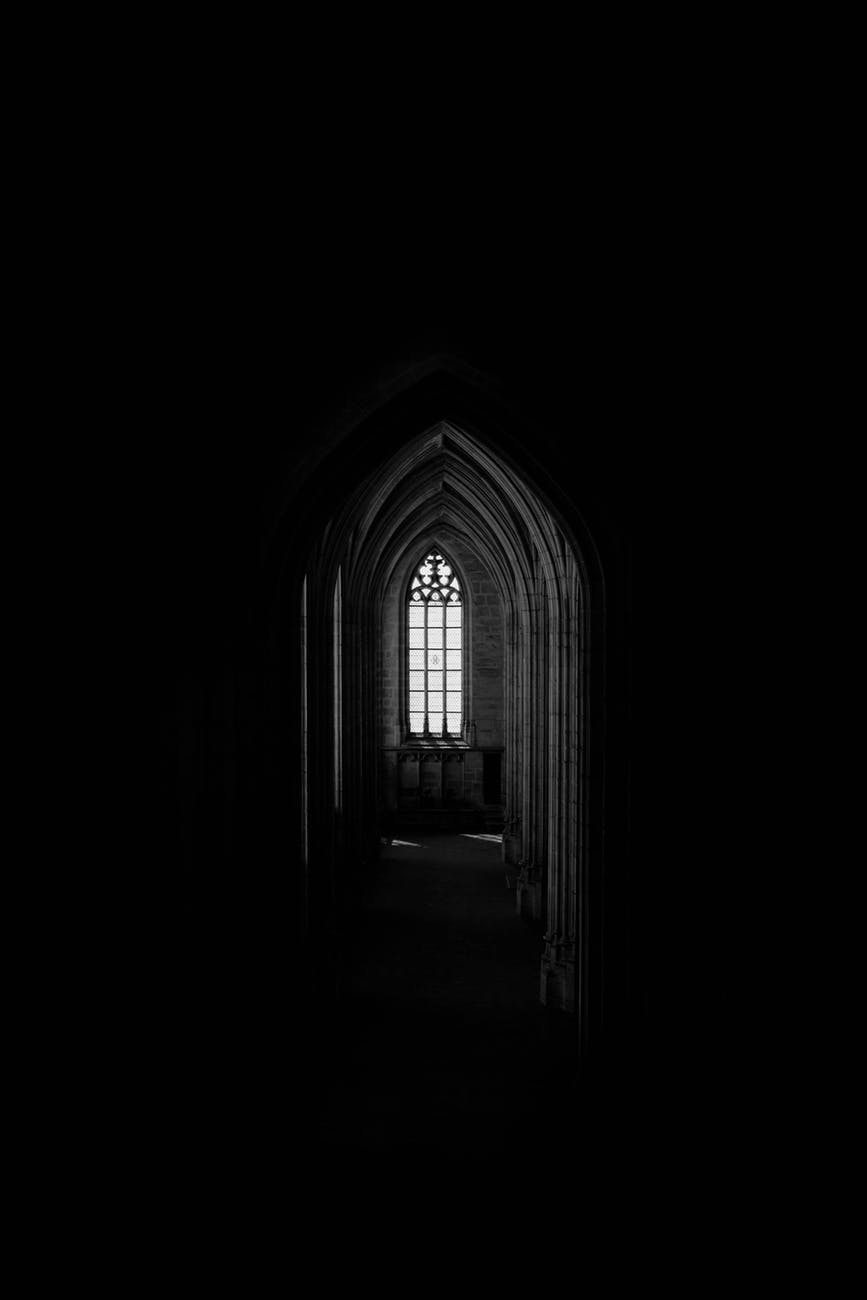 monochrome photo of dark hallway